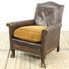 Brown Faux Leather Studded Easy Chair With Carved Wooden Panels And Antique Gold Seat Cushion