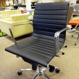 Black Leather & Chrome Eames Style Ribbed Low Back Swivel Chair