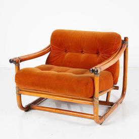 Low Wide Bamboo Armchair With Orange Cushions