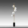 """Antique Brass """"Tempo"""" Floor Lamp with White Glass Orb Shades"""