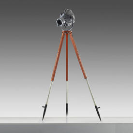 industrial Spotlight on Orange Tripod Base