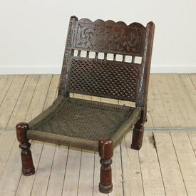Low Carved Dark Oak Folding Tribal Chair with Raffia Seat