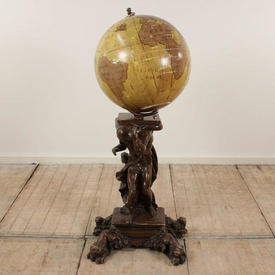 Globe on Carved Wooden Figure