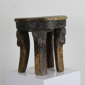 Wooden Low 4 Legged Stool with Carved Face Patt