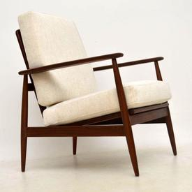 Cream Fabric Cushioned Afromosia Wood Armchair.
