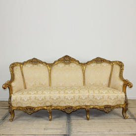 Heavily Carved Gilded Sofa with Pale Gold Damask Uphostery