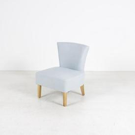 Low Pastel Blue Fabric Bedroom Chair on Light Wood Legs