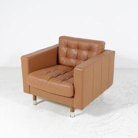 Pinched Tan Pvc Armchair on Chrome Legs with Covers on