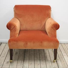 Burnt Orange Velvet Upholstered Easy Chair on Mahogany Legs with Brass Front Castors